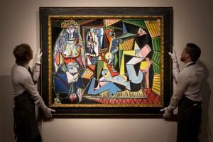 "Art handlers hanging Picasso's ""Women of Algiers"" (""Les Femmes d'Alger (Version 'O')"" painting"