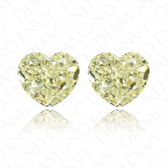 8.18 Total Carat Weight Heart-Shaped Pair of Fancy Light Yellow Diamonds