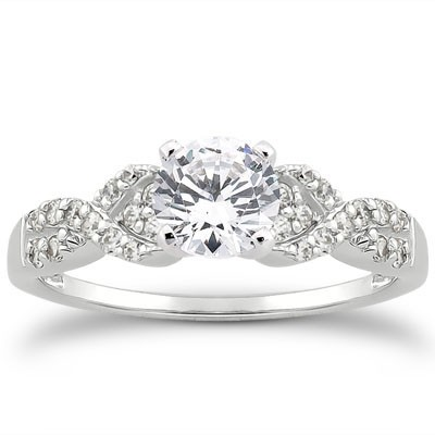 Contemporary style engagement ring with pave set diamond twisted band