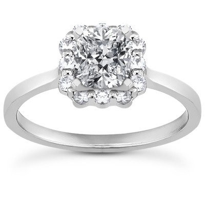 Contemporary style engagement ring with flower style halo setting