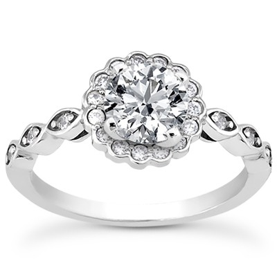 Vintage style engagement ring with delicate diamond band and flower style halo