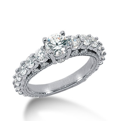 Graduated eternity band engagement ring with milgrain detail