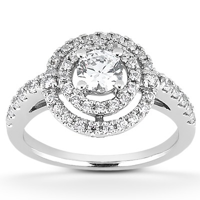 Contemporary style engagement ring with pave set diamond band and floating double halo