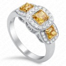 0.87 Carat Fancy Vivid Orange Yellow Radiant Diamond Ring in 18K White Gold